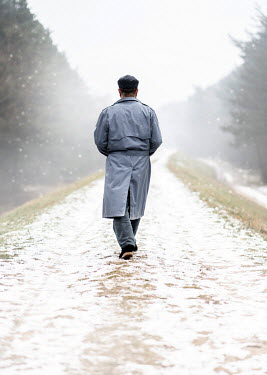 Jaroslaw Blaminsky MAN WALKING ON SNOWY COUNTRY LANE Men