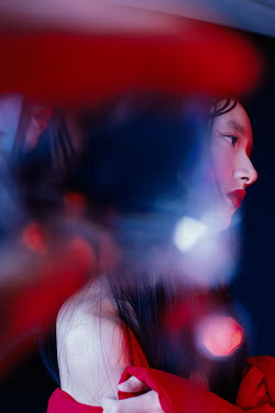 Marta Syrko CLOSE UP OF SAD ASIAN GIRL IN PROFILE Women