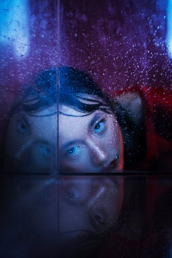Marta Syrko ASIAN GIRL STARING THROUGH WET GLASS Women
