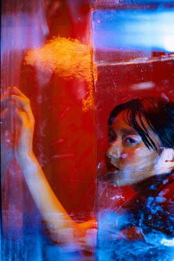 Marta Syrko ASIAN GIRL BY WINDOW WITH RED LIGHT Women