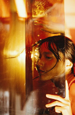 Marta Syrko ASIAN GIRL WITH FACE IN WATER AND GOLDEN LIGHT Women
