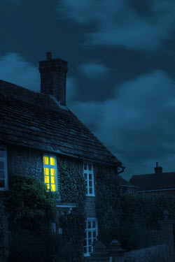 Magdalena Russocka light in window of historical house at night