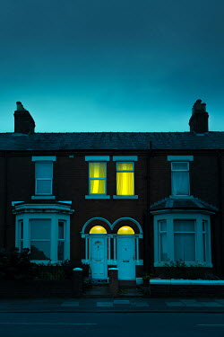Magdalena Russocka lights in windows of old terrace houses at night