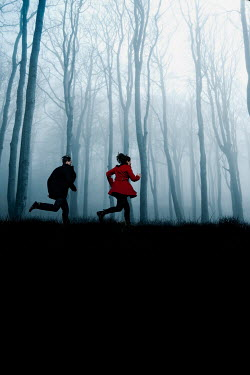 Rekha Garton COUPLE RUNNING BY FOGGY FOREST AT DUSK Couples