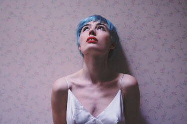 Anna Rakhvalova CLOSE UP OF ANXIOUS WOMAN WITH BLUE HAIR AND RED LIPS Women