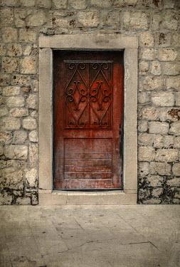 Jaroslaw Blaminsky EXTERIOR OF STONE BUILDING WITH BROWN WOODEN DOOR Building Detail