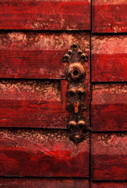 Jaroslaw Blaminsky CLOSE UP OF RED WOODEN DOOR WITH DECORATIVE LOCK Building Detail