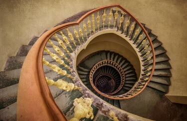 Jaroslaw Blaminsky EMPTY SHABBY SPIRAL STAIRCASE FROM ABOVE Stairs/Steps