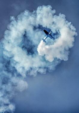 Jaroslaw Blaminsky Airplane with contrails in sky