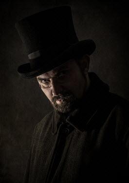 Jaroslaw Blaminsky Man in top hat and glasses in shadow