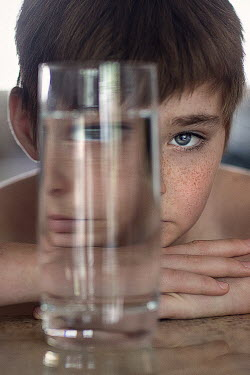 Jessica Drossin Boy behind glass of water