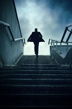 Magdalena Russocka modern man running up urban steps from behind
