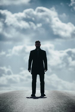 Magdalena Russocka modern man standing on empty road