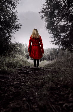Stephen Mulcahey BLONDE WOMAN IN RED COAT STANDING IN COUNTRYSIDE Women