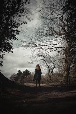Shelley Richmond Woman in black coat on park path