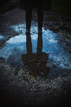 Shelley Richmond Reflection of woman in puddle