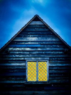 Trevor Payne Light through window of wooden house