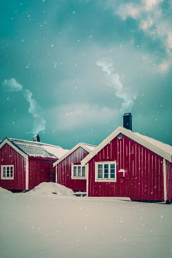 Des Panteva RED WOODEN CABINS IN SNOW WITH CHIMNEY SMOKE Houses