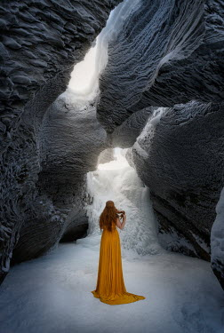 Viktoria Haack WOMAN WITH RED HAIR BY FROZEN RIVER IN CAVE Women