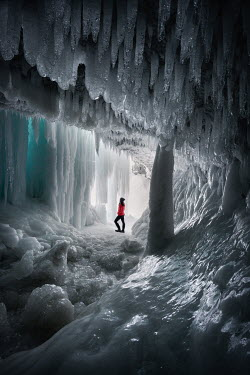 Viktoria Haack WOMAN STANDING IN ICY CAVE Women