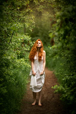 Viktoria Haack BAREFOOT WOMAN WITH RED HAIR ON COUNTRY PATH Women