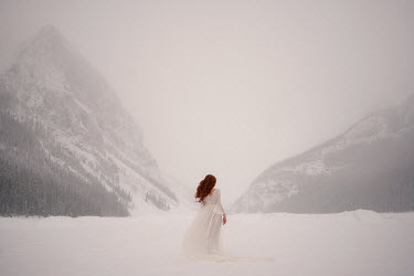 Viktoria Haack WOMAN IN WHITE GOWN BY SNOWY MOUNTAINS Women