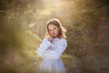 Viktoria Haack LITTLE GIRL IN WHITE DRESS IN GARDEN Children
