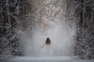 Viktoria Haack WOMAN IN WHITE DRESS IN SNOWY FOREST Women