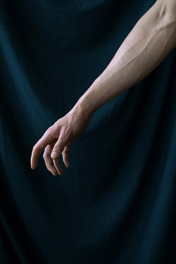 Dmitriy Bilous Arm of man by curtain
