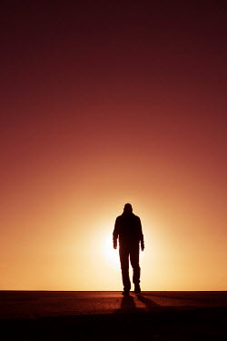 Tim Robinson Silhouette of man at sunset