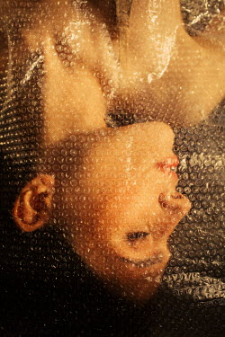 Marta Syrko Young woman under bubble wrap