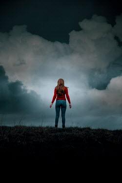 Rekha Garton Woman in red sweater standing on hill