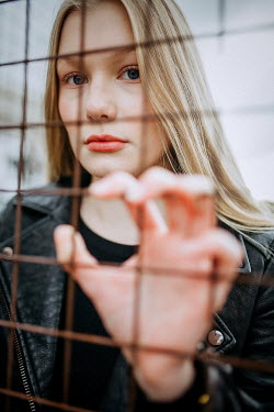 Shelley Richmond Young woman behind fence