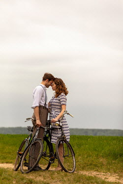 CollaborationJS COUPLE EMBRACING WITH BICYCLES IN COUNTRYSIDE Couples