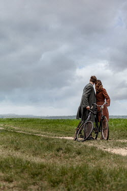 CollaborationJS RETRO COUPLE WITH BICYCLES ON COUNTRY PATH Couples