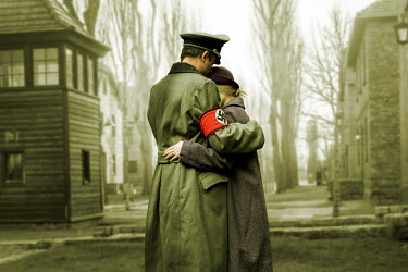 CollaborationJS ww2 couple embracing outside a prison camp Couples