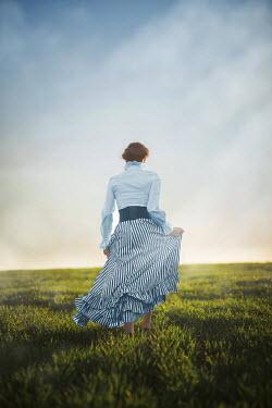 Ildiko Neer Historical woman walking in field