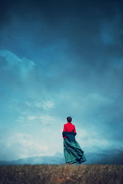 Magdalena Russocka historical woman standing on hill with mountainscape
