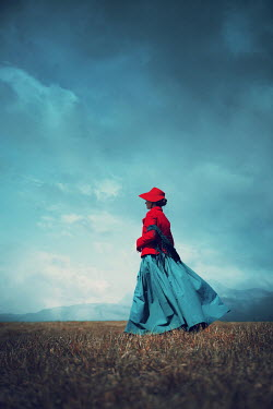 Magdalena Russocka historical woman walking on hill with mountainsacape