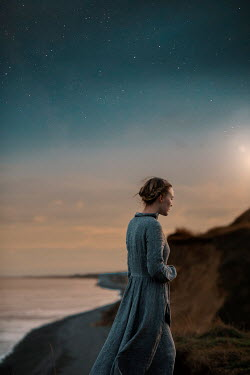 Rekha Garton WOMAN ON CLIFFS BY SEA WITH STARRY SKY Women