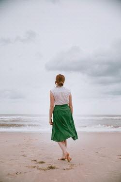 Rekha Garton BAREFOOT WOMAN WALKING ON SANDY BEACH Women