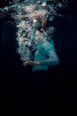 Rekha Garton WOMAN UNDERWATER WITH BUBBLES Women