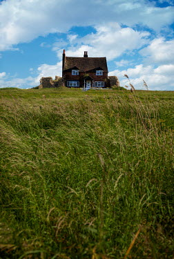 Stephen Mulcahey COTTAGE IN FIELD WITH BLUE SKY Houses