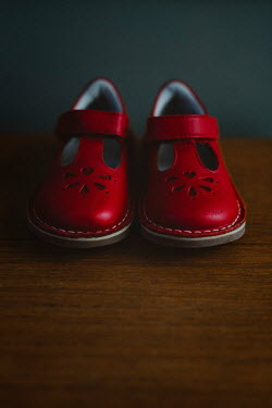 Shelley Richmond CLOSE UP OF TODDLER'S RED SHOES Miscellaneous Objects
