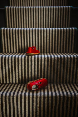 Shelley Richmond CHILDREN'S RED SHOES ON STAIRCASE Miscellaneous Objects