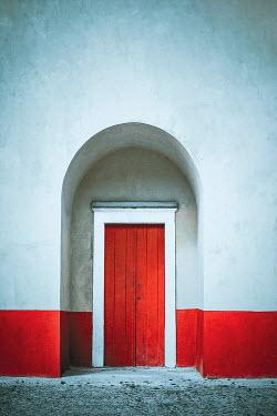 Evelina Kremsdorf EXTERIOR OF BUILDING WITH RED DOOR IN ARCHWAY Building Detail