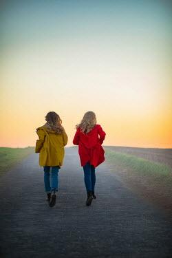 Ildiko Neer Two women running on country road