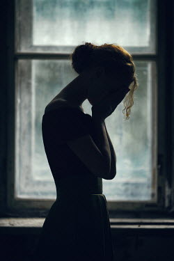 Magdalena Russocka weeping woman standing by old window
