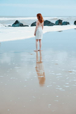 Rekha Garton WOMAN WITH RED HAIR ON SANDY BEACH Women