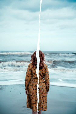 Rekha Garton WOMAN WITH RED HAIR ON BEACH WITH VERTICAL TEAR Women